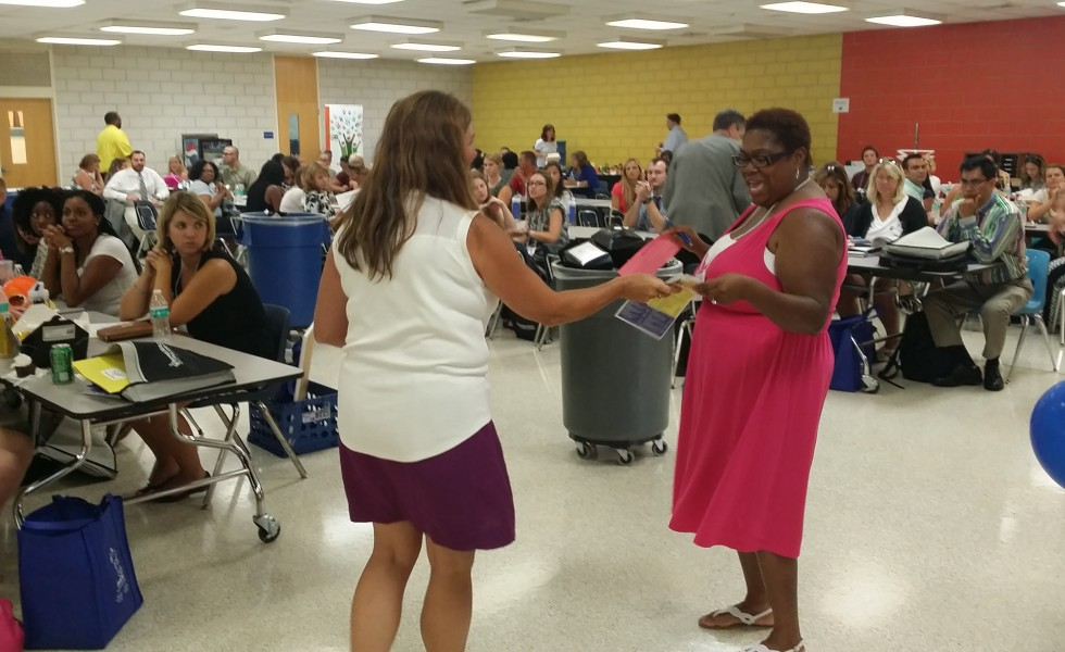 VBEA vice president Kelly Walker speaks with a new VBEA member during TOCLI, new teacher orientation.